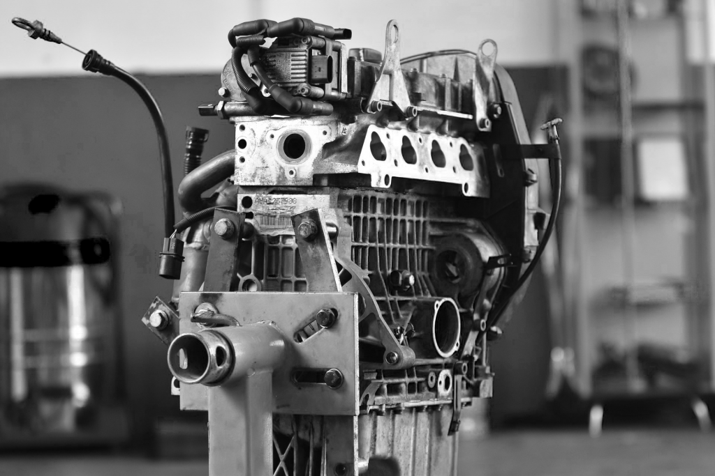 black and white image of car engine